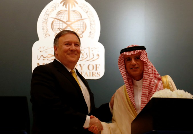 U.S. Secretary of State Mike Pompeo shakes hands with his Saudi counterpart Adel al-Jubeir