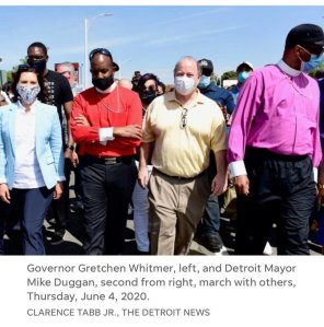 Mich. Gov and Mayor march with protesters